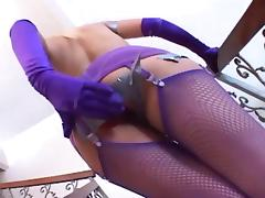 Kinky anal play in purple fishnets and gloves