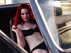 Redhead Alyssa Michelle poses in lingerie in a car