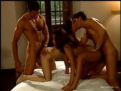 Two horny couples have wild group sex in a bedroom