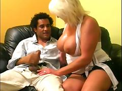 Busty mature lady is having fun ont he couch