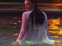 Pretty Alyssa Arc poses for the camera in a pool