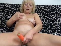 Age-old blonde Evan is playing with a hardcore dildo