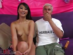 Evelyn Lin toys the brush pussy and gives a hot blowjob in the matter of some ladies' porn tube video