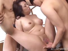Japanese cougar Neko Ayami gets fucked by two studs in slay rub elbows with kitchen