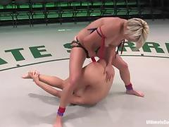 Blond wrestler is fucking her opponent with a huge strapon tube porn video