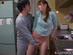 Asian housewife sucks a dick and fucks in a kitchen