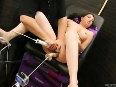 Horny brunette MILF gets toyed rough by a sex machine