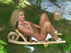 Charming blonde Silvia Saint plays with her pussy in the garden tube porn video