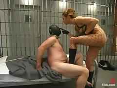 Hot mistress in police uniform dominates a guy in a prison porn tube video