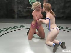 Tanned blonde gets toyed after a a fight by pale redhead girl