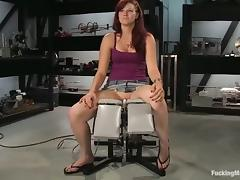 Nasty redhead is being penetrated hard by a machine