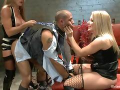 Two nasty blonde mistresses torture some man in a suit