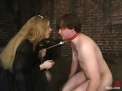 Neil gets humiliated and beaten by Princess Kali in a basement tube porn video