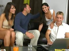Two cute tanned brunettes get unforgettably fucked by two men