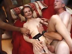 Skinny granny Gigi gets her mouth and pussy pounded by two guys