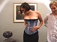 A fucking machine bangs her, while she polishes a real one