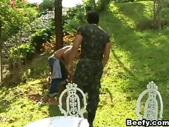 A guy in military uniform fucks a civilian guy in a park porn tube video