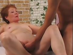 Blonde granny Nathalie toys her cunt and gets it pounded from behind