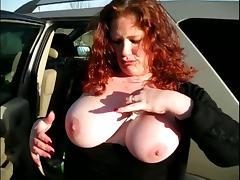 Busty Redhead Sucks a Big Shaft Out Of a Gloryhole in Public