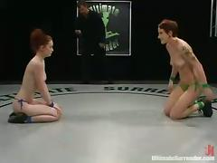 Two redhead chicks have wild sex using strap-on in a ring