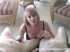 Horny blonde mom enjoys sucking and rubbing two dicks tube porn video