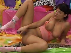 Jenny shows her big natural boobs and masturbates