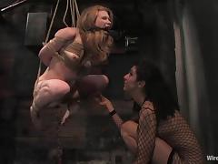 Redhead Madison gets hog tied and toyed in a basement tube porn video
