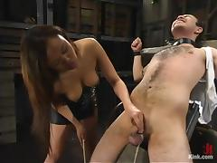 Asian hussy Annie Cruz enjoys torturing Sir C in a basement porn tube video