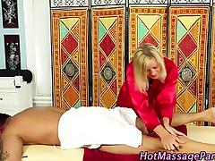 Hot blonde masseuse rubbing down client
