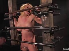 Krissy Lynn moans in pleasure while being tortured in a cellar tube porn video