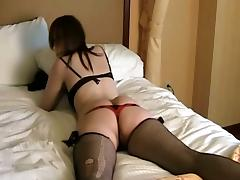 Nice thong panties on this cute bitch in her lingerie on bed