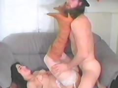 Brunette skank toys her cunt and gets fucked by a long-haired dude