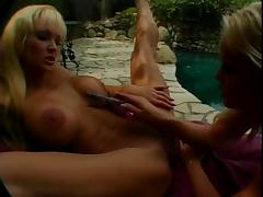 Frisky blonde lesbians with huge round melons pussy eat and dildo fuck outdoors