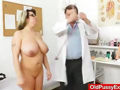 This MILF has some seriously big natural tits and it is insertion time as she hits the exam table tube porn video