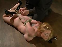 Busty Darling gets humiliated and tortured by a guy in a mask