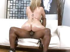 Blonde skank with huge knockers is fucked by black man