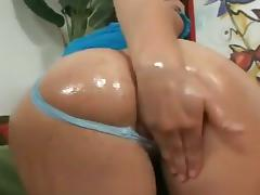 This bitch in her thong panties is fingering her wet cunt before having a good hardcore fuck