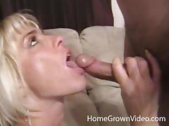 Slutty MILF with fake tits sucks a dick in POV video tube porn video