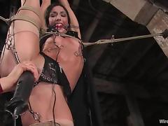Wenona enjoys getting her holes fucked hard with toys in BDSM scene
