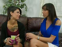 Two tattooed brunettes show their cock-sucking skills to some dude