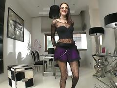 Sexy Brunette in Fishnet Stockings Shows Her Shaved Pussy