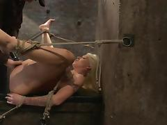 Big titted slave gets a spreader bar in her legs
