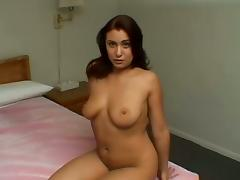 Busty brunette Melanie sucks and rubs a cock and enjoys it much