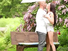 Long-haired brunette gets banged doggy style in the garden