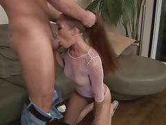 Whore in fishnet is working hard on his cock