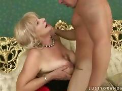 Hot busty grandma enjoying hard sex
