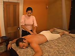 Exotic masseuse gives a great handjob to some dude