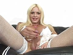 Blonde tranny in fishnets fucks a guy from behind.