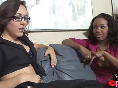 Ebony and brunette are having fun with some toys