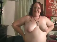 Fat redhead girl in glasses sucks a dick and gets fingered